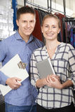 Portrait Of Couple Running On Line Fashion Business Stock Image