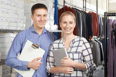 Portrait Of Couple Running On Line Fashion Business Stock Photo