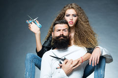 Portrait of couple with scissors Royalty Free Stock Images