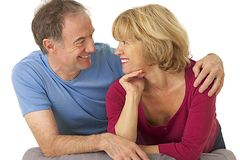 Portrait of couple of seniors --tender look and complicity Stock Images