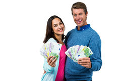 Portrait of couple showing money Royalty Free Stock Photos
