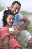 Portrait of couple sitting on beach Royalty Free Stock Photography