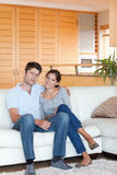 Portrait of a couple sitting on a couch Stock Photo