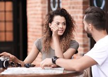 Beautiful loving couple sitting in a cafe enjoying in coffee stock photo