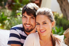 Portrait Of Couple Sitting Outdoors In Garden Together Royalty Free Stock Photo