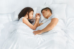 Portrait of couple sleeping in the bed Royalty Free Stock Images