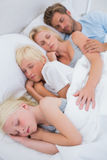Portrait of a couple sleeping with their children Royalty Free Stock Image