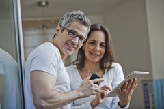 Portrait of a couple smiling at home Stock Photos