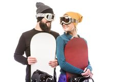 Couple with snowboarders Royalty Free Stock Images
