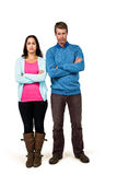 Portrait of couple standing with arms crossed Stock Photo