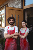 Portrait of couple standing with arms crossed Royalty Free Stock Image