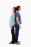 Portrait of a couple standing back to back Royalty Free Stock Images