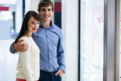Portrait of couple standing in front of shop display Royalty Free Stock Images