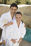 Portrait Of A Couple Standing By Pool Stock Photo