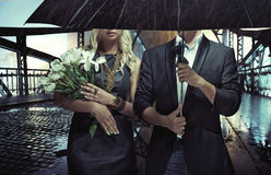 Portrait of the couple standing in the rain Stock Photo