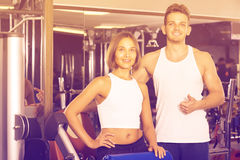 Portrait of  couple standing together in gym indoors Stock Photography