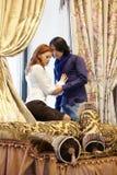Portrait of couple standing beside window Royalty Free Stock Image