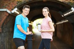 Portrait Of Couple Taking A Break During Exercise In Urban Envir. Couple Taking A Break During Exercise In Urban Environment Stock Photos