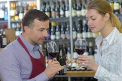 Portrait couple tasting wine. Portrait of a couple tasting wine Royalty Free Stock Photos