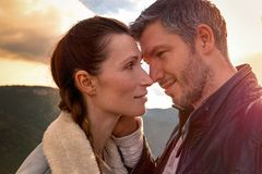 Couple teasing. Portrait of couple teasing in autumn fall royalty free stock photos
