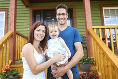 Portrait of couple with their adorable daughter in Stock Images