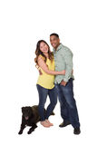 Portrait of a couple and their dog. White Stock Images