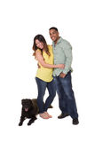 Portrait of a couple and their dog. White Royalty Free Stock Photography