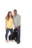 Portrait of a couple and their dog. White Royalty Free Stock Photos