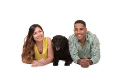 Portrait of a couple and their dog. White Royalty Free Stock Photo