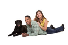 Portrait of a couple and their dog. White Stock Photography