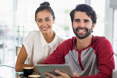 Portrait of couple using digital tablet in cafe Royalty Free Stock Images