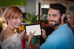 Portrait of couple using digital tablet Stock Images