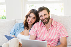 Portrait of couple using digital tablet and laptop Royalty Free Stock Image