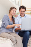 Portrait of a couple using a laptop Royalty Free Stock Image