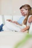Portrait of a couple using a laptop Stock Image