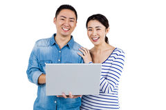 Portrait of couple using laptop Royalty Free Stock Photos