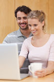 Portrait of a couple using a notebook Royalty Free Stock Photo