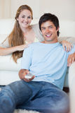 Portrait of a couple watching television Royalty Free Stock Image