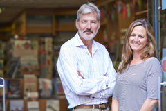 Portrait Of Couple Who Own Bookshop Outside Store Stock Images