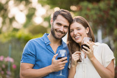 Portrait of couple with wine. At park royalty free stock photo