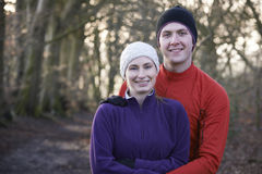 Portrait Of Couple On Winter Run Through Woodland Stock Photos