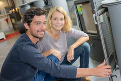 Portrait couple in woodburner store Stock Photography