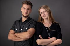 Portrait of a couple of young business people and partners royalty free stock photography