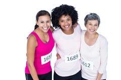 Portrait courbe des athlètes féminins heureux Photographie stock libre de droits