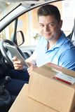 Portrait Of Courier In Van With Digital Tablet Delivering Package To House royalty free stock images