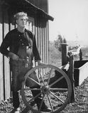 Portrait of craftsman with wooden wheel Stock Images