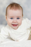 Portrait of a crawling baby on the bed in her room Royalty Free Stock Images