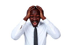 Portrait of a crazy african businessman shouting Royalty Free Stock Image