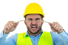 Portrait of crazy electrician over white background royalty free stock photo