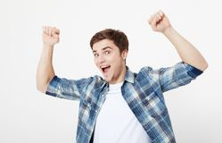 Portrait crazy excited happy man standing with raised hands and looking at camera isolated on white background. Student Pass exam. Portrait crazy excited happy Stock Image